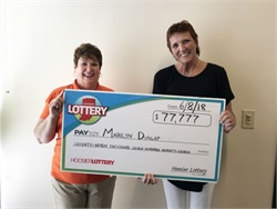Marilyn Dunlap (right), a retired school bus driver, won $77,777 on a lottery scratcher. She is seen here with Hoosier Lottery Executive Director Sarah Taylor. Photo courtesy Hoosier Lottery