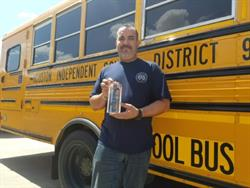 Mahmoud Chami, transportation mechanic team lead at Houston Independent School District, shows off the Leadership with Propane Autogas Award that the district received recently.