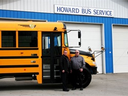 Dale Howard, owner of Ontario, Canada-based Howard Bus Service (right), received six IC Bus CE Series gasoline-powered school buses from Dave Thomas, sales representative for Leeds Transit.