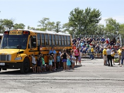 Students from Mitchellville Elementary School in the Southeast Polk Community School District in Iowa demonstrate a school bus evacuation drill for attendees at the Iowa Pupil Transportation Association Conference in July 2019. Photo courtesy Iowa Department of Education