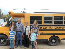 Ila Beemer started driving a school bus in 1954, while a junior in high school, and retired in May. She is shown here, center, surrounded by her son,  grandchildren, and great-grandchildren.