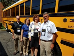 Jericho (N.Y.) School District's amenity-equipped school bus is seen here with (from left) Bob Blaisdell and Susan Boyle of the New York Schools Insurance Reciprocal, Lori-Ann Savino of Jericho School District, and John Clare of Thomas Built Buses dealership Nesco.