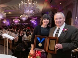 Chestnut Ridge Transportation was awarded the Good Samaritan Hospital Medal of Honor. John Corr Jr. (right), the president of The Trans Group, received the award from Mary Leahy, M.D., CEO of Bon Secours Charity Health System.
