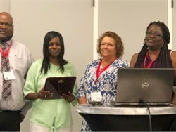 Juliette Washington, second from the left, was named the 2018 bus driver of the year by the Beaufort County (S.C.) School District and by the South Carolina Association for Pupil Transportation. Also shown from left: James Young, president of the association; Maria McClure, director of transportation for the school district; and Tori Mitchell, the district's transportation supervisor. Photo courtesy Jerry Green