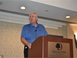 Ken Hedgecock, formerly of Thomas Built Buses, is joining Fogmaker North America as its new national sales manager. Hedgecock is shown here speaking at the National Association of State Directors of Pupil Transportation Services conference in October.