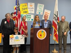 Los Angeles Unified School District has approved a resolution to commit to using 100% clean, renewable energy by 2040. Shown center is Lisa Oyos, program director for the Sierra Club Climate Parents, and LAUSD board of education member Scott M. Schmerelson. Photo courtesy Elvia Perez