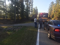 A Lancaster County (S.C.) School District bus had stopped to pick up a student when a logging truck that was traveling toward the bus swerved to avoid another truck that was stopped for the bus. Photo courtesy Bryan Vaughn