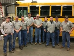 The Lee's Summit R-7 School District's transportation department received the Total Fleet Excellence Award from the Missouri State Highway Patrol. Shown here are maintenance staff members.