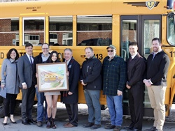 Marriana Mattice (fourth from left) is the latest winner of Leonard Bus Sales' A Day in the Life of a School Bus Art Competition. She is shown here with staff members from Leonard Bus Sales and Mayfield Central School District. Photo courtesy Leonard Bus Sales