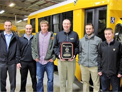 Jon Leonard (second from right) is the new president of Leonard Bus Sales. He is shown here with his father, Mike (third from right), and his brothers from left to right: Ben, Dan, Chris, and Patrick. Photo courtesy Leonard Bus Sales