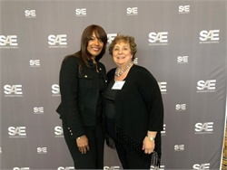 Leslie Kilgore (left) of Thomas Built Buses was honored by SAE International with an engineering award named for Rodica Baranescu (right).