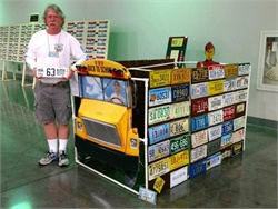Retired pupil transporter Louk Markham has amassed school bus plates from across the U.S. as well as Canada.