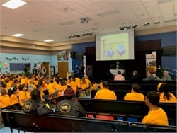 "The American School Bus Council launched its annual ""Love the Bus"" campaign at Orange County (Fla.) Public Schools. Shown here speaking to students is A.L. Reeves, director of mentoring at Harford County (Md.) Public Schools. Photo courtesy National School Transportation Association"