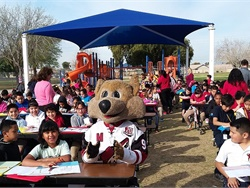 "Glendale (Ariz.) Elementary School District #40 hosted its third annual ""Love the Bus – No Bullies On Board"" event on Feb. 14. Students made valentine cards for their school bus drivers and monitors with help from Arizona Coyotes professional hockey team mascot ""Howler."""