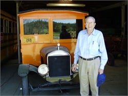 "Albert ""Buddy"" Luce Jr. is seen here with Blue Bird No. 1, the company's first steel-body school bus. Photo by Kevin Neafie"