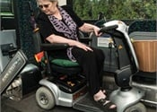 Quantum automatic rear-facing wheelchair securement station