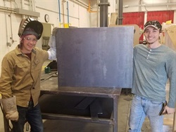 Mason Smith (left) and Brayden Hudson, students at Moore Norman Technology Center and Moore High School, worked together to build a new wheelchair ramp for a family in need. Photo courtesy MNTC