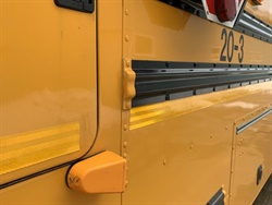 Gov. Janet Mills signed into law a bill that allows the use of stop-arm and exterior cameras to catch motorists who illegally pass school buses. File photo courtesy Adam Mayo