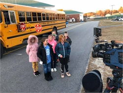 A group of RSU 14 Windham Raymond (Maine) Schools students, with support from school staff and community members, are working to raise nearly $33,000 to add 15 extended stop arms to buses on routes in their district with high numbers of illegal passing incidents. Photo courtesy Carrie Menard