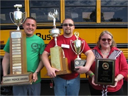 Mary Sansaricq (right) served as New York's state director for the past five years. She is seen here with NYSBCA President Mike Martucci (left) and award-winning driver Corey McAbier at the 2017 New York State School Bus Safety Competition in May.