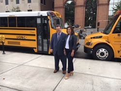 Seven Michigan districts will receive funds to buy electric school buses. Shown here is Gov. Gretchen Whitmer and Eric Marquis, Quebec's assistant deputy minister of international affairs and Francophonie. Photo courtesy Michigan Department of EGLE