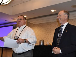 Mike LaRocco, the president of NASDPTS and Indiana state director (shown left), introduced Bruce Landsberg, the vice chairman for the National Transportation Safety Board (NTSB), who discussed safety recommendations from the agency. Those included physical performance testing, evacuation training, and lap-shoulder belts.