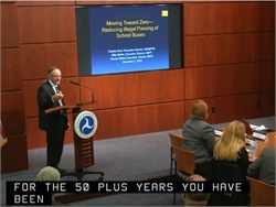 During a NHTSA meeting, industry association officials asked the agency to raise public awareness on the dangers of illegal passing of school buses. At the podium is Charlie Hood of NASDPTS. Screenshot from NHTSA webcast