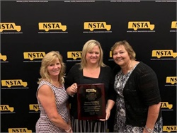 Jessica McMillion of Wilson's Bus Service Inc. in Millersville, Md. (center), is one of the recipients of NSTA's Golden Merit Award. Photo courtesy NSTA