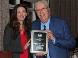 State Sen. Carl Marcellino received the New York School Bus Contractors Association's Legislator of the Year Award. He is seen here with association President Bree Allen.