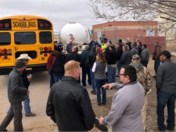 Three New Mexico school districts will receive the first propane school buses to operate in the state. Shown here is a propane fueling demonstration. Photo courtesy Roush CleanTech