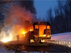 A New York school bus driver noticed sparking in the engine compartment, saw smoke and flames, and safely evacuated the students aboard. Photo courtesy New York State Police