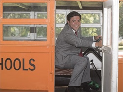 Mark Johnson, North Carolina's state superintendent of public instruction, takes the wheel of a vintage 1930s school bus at an event recognizing the 100th anniversary of motorized school transportation in the state. Photo courtesy North Carolina Department of Public Instruction
