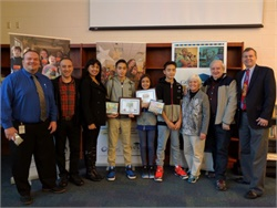 Artistic siblings Petar, Anita, and Angel Krastev are seen at center with (from left) Jeff Harris of Guilford County (N.C.) Schools, their parents, their grandparents, and state director Derek Graham.