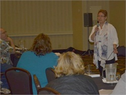 An Oregon Pupil Transportation Association (OPTA) workshop will cover such topics as lessons from the Reynolds High School shooting. Seen here is Kathy Houck speaking on that subject at the OPTA 2015 conference.