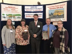 During a School Bus Safety Week event in October, Pennsylvania School Bus Association President Fred Bennett (center) recognized some of the top drivers in the state's safety competition: Ruth Del Vechhio (left), Shanon O'Brien, Ted Dubbs, and Cheryl Vogelsang.