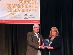 Q'Straint/Sure-Lok is calling for nominations for the annual NAPT Special Needs Transportation Award. Shown here is J.W. Bud Fears, Q'Straint's midwest regional sales manager, presenting Peggy Stone with the award in 2018.