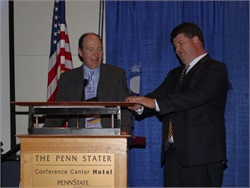 "Randall Smith (left) of Smith Bus Co. receives the ""Bus Stops Here"" award from Fred Bennett, president of the Pennsylvania School Bus Association."