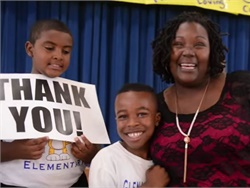 Renita Smith, who evacuated 20 students when her bus caught on fire, was recently recognized in an assembly at Glenarden Woods Elementary School. Screenshot from Prince George's County Public Schools video