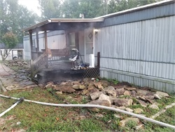 Norman Miller, a driver with Lee County School District, was able to stop his bus and rescue a family after the front porch of their mobile home caught fire. Photo courtesy Lee County Emergency Management.