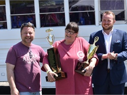 Cynthia Peters (center), the winner in the Conventional Bus (Type C) category, is shown here with NYSBCA President Corey Muirhead (right).