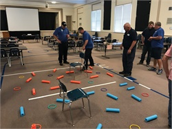 "Management class attendees took part in a leadership game called ""catching a snake"" with the objective of the group, or ""snake"" working together to fill a bucket with 10 balls. Photo courtesy Mike Vivar"