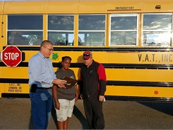 Communication between all transportation departments is essential. Tracy Williams (left), the safety director for VAT Inc., along with bus specialist Cheri Butts and Brian Hamlin, shop manager, review a safety checklist at the company's bus lot.