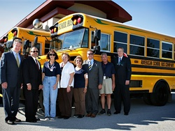"""Cook-Illinois Corp.'s school bus purchase this year was all propane (pictured) and gasoline models. """"This was the first year we did not buy one diesel bus,"""" says COO John Benish Jr., third from right."""
