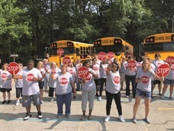 "Michigan City (Ind). Area Schools' transportation department recently recreated The Supremes' famous ""Stop in the Name of Love"" — urging motorists to think twice before illegally passing a stopped school bus. Photo courtesy Michigan City Area Schools"
