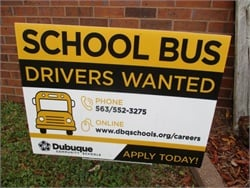 Dubuque (Iowa) Community Schools is using yard signs — normally the domain of real estate agents and political candidates — to recruit school bus drivers.