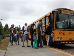 Families prepare to board buses for Issaquah (Wash.) School District's annual ride-along for kindergartners and their families.