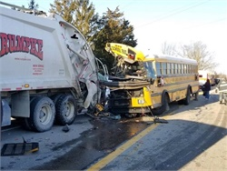 Twenty-one people, including 19 students, weretaken to the hospital after the school bus collided with a garbage truck. One student was transported for severe injuries. Photo courtesy Indiana State Police