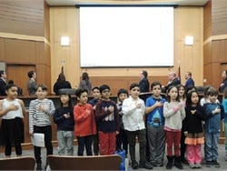 Third grade students from Hilltop Elementary School in Beachwood, Ohio, led the pledge of allegiance at a Beachwood City Council meeting on Dec. 17, before council members approved legislation to install seat belts on new school buses.