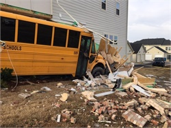 A driver for Charlotte-Mecklenberg (N.C.) Schools was cited for failing to maintain lane control after her bus hit a stopped car, causing the bus to veer off the road and hit the building. Photo courtesy Charlotte Fire Department