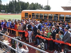 Franklin Pierce Schools unveiled the district's and the state's first electric school bus during a ribbon-cutting ceremony on Monday. Photo courtesy Office of Gov. Inslee